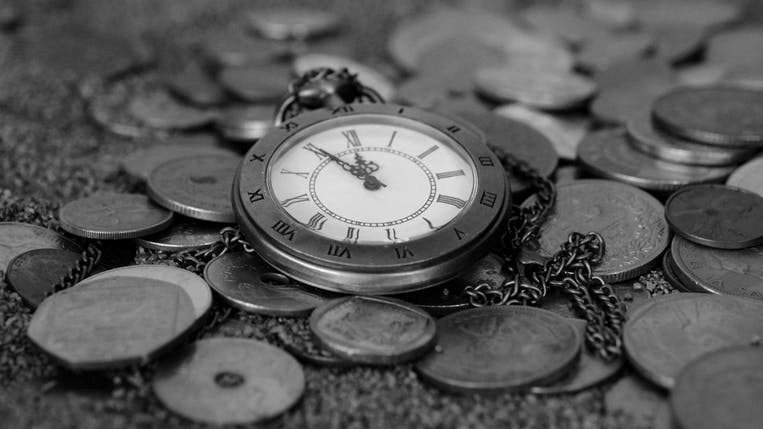 Image clock and pennies the difference between debt collection and enforcement
